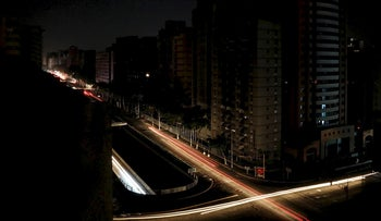 Car lights are seen on one of the main roads of the city during the second day of a blackout in Caracas, Venezuela March 9, 2019