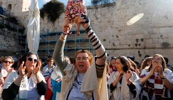 A member of the liberal Jewish religious movement 'Women of the Wall' at the egalitarian prayer section of the Western Wall in the Old City of Jerusalem, March 8, 2019.