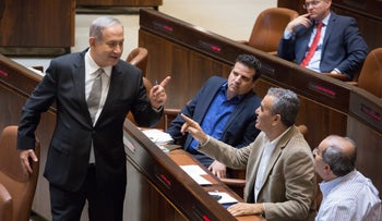 Netanyahu with lawmakers Ahmad Tibi, Jamal Zahalka and Ayman Odeh in the Knesset.
