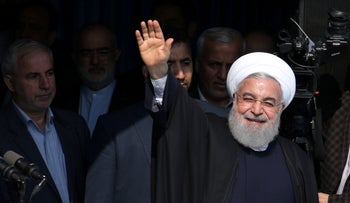 Iranian President Hassan Rohani waves to supporters, Gilan, Iran, March 6, 2019.