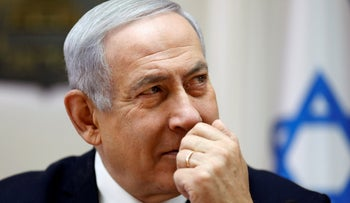 File photo: Israeli Prime Minister Benjamin Netanyahu chairs the weekly cabinet meeting at his Jerusalem office, March 10, 2019.