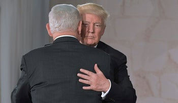 U.S. President Donald Trump (right) and Prime Minister Benjamin Netanyahu hug after speaking at the Israel Museum in Jerusalem, May 23, 2017.