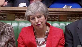British Prime Minister Theresa May reacts to results of Brexit vote in Parliament, London, March 12, 2019.