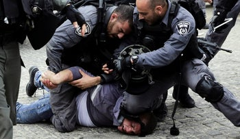 A Palestinian is detained by Israeli police after police blocked the entrances to Al-Aqsa compound in Jerusalem, March 12, 2019.