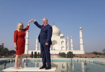 Israeli Prime Minister Benjamin Netanyahu and his wife Sara pose for a photograph at the Taj Mahal, India. January 16, 2018