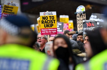 Demonstrators hold flags and placards during an Anti-Tommy Robinson and UKIP rally in central London, Britain, December 9, 2018.
