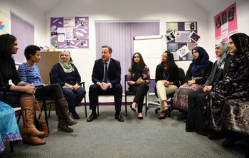Britain's Prime Minister David Cameron, center, meets women attending an English language class during a visit to the Shantona Women's Centre in Leeds, Monday, Jan. 18, 2016.