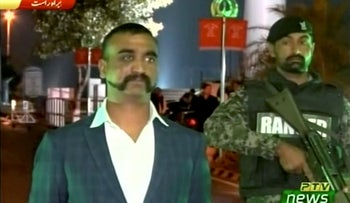 Indian pilot, Wing Commander Abhinandan, downed in an aerial dogfight with the Pakistani air force, under armed escort before his release. Pakistan-India border, March 1, 2019