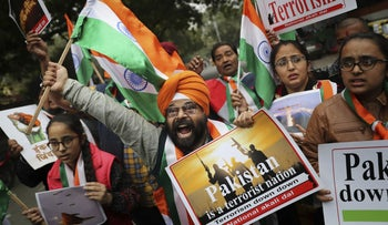 A National Akali Dal leader shouts slogans in support of India and against Pakistan as he celebrates reports of Indian aircrafts bombing Pakistan territory, in New Delhi, India, February 26, 2019.