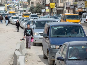 Drivers wait to pass through Qalandiyah checkpoint, West Bank, March 13, 2019.
