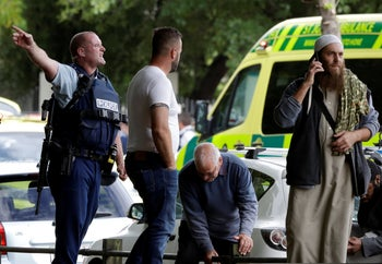 Police attempt to clear people from outside a mosque in central Christchurch, New Zealand, March 15, 2019.