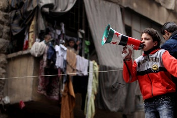 File photo: A boy shouts into a loud hailer during a protest against Syria's President Bashar al-Assad in the Bustan al-Qasr district in Aleppo, Syria, January 11, 2013.