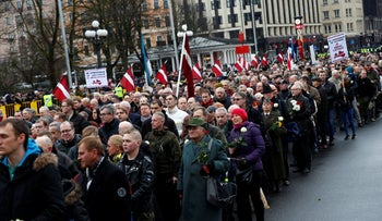People attend the annual procession to commemorate the Latvian Waffen-SS (Schutzstaffel) unit, also known as the Legionnaires in Riga, Latvia, March 16, 2019.