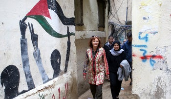 Hollywood actress and social activist Susan Sarandon walks with Mariam Shaar, a Palestinian entrepreneur in Burj al-Barajneh refugee camp in Beirut, Lebanon March 4, 2019. Picture taken March 4, 2019.