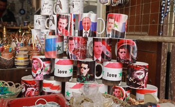 Mugs bearing the portraits of Syrian President Bashar Assad and Russian President Vladimir Putin are sold in the old city of Damascus, Syria. March 12, 2019