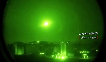 An image grab from a video broadcast purportedly shows Syrian air defense systems intercepting Israeli missiles on May 10, 2018.