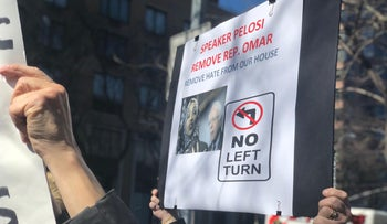 A protester at the rally in New York, holding a placard calling for the removal of Rep. Ilhan Omar from the House of Representatives, March 15, 2019.