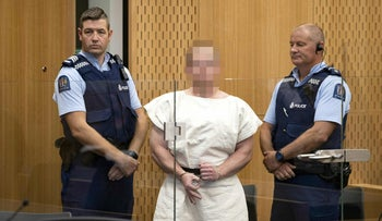 File photo: Brenton Tarrant, the man charged in relation to the Christchurch massacre, makes a sign to the camera during his appearance in the Christchurch District Court on March 16, 2019.