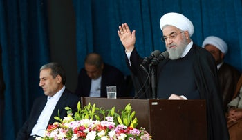 Iranian President Hassan Rohani gestures to the crowd at a public speech in Bandar Kangan, Iran, March 17, 2019.