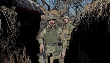 """Members of Ukrainian Interior Ministry's """"Azov"""" battalion are seen at a their position at a front line near the village of Travneve, Ukraine February 24, 2019"""