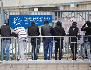 File photo: Asylum seekers wait in line at the Population, Immigration and Border Authority office in Bnei Brak, central Israel, April 11, 2018.