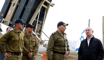 File photo: Prime Minister Benjamin Netanyahu speaks with soldiers as he stands near a naval Iron Dome defense system in the northern port of Haifa, Israel, February 12, 2019.