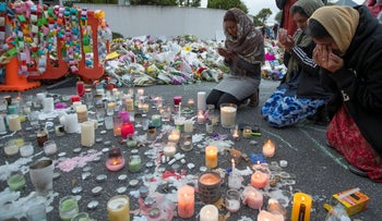 People mourn at a makeshift memorial site near the Al Noor mosque in Christchurch, New Zealand, March 19, 2019.
