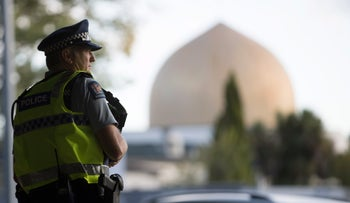 A police official stands guard in front of the Al Noor mosque in Christchurch, New Zealand, March 19, 2019.