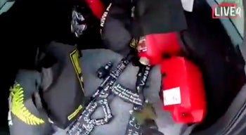 A frame from the video livestreamed by Brenton Tarrant showing him reaching for a gun in the back of his car before shooting dead 50 Muslims at prayer in mosques in Christchurch, New Zealand. March 15, 2019