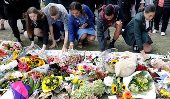 Students from Christchurch high schools light candles at a floral tribute at the Botanical Gardens in Christchurch, New Zealand, March 19, 2019.