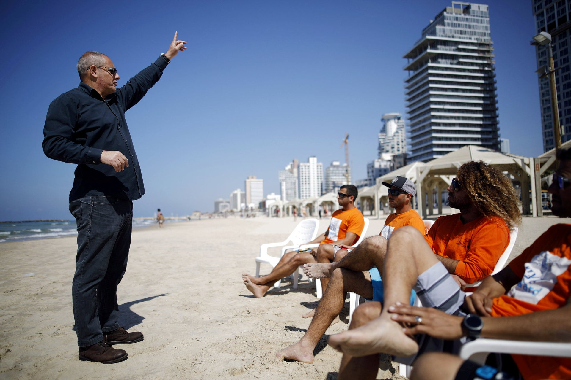 Life guards participate in a training session as part of an initiative by the Tel Aviv municipality to equip service industry workers with skills to help them treat tourists politely, as the city prepares to host visitors during the Eurovision Song contest, in Tel Aviv, Israel March 6, 2019.