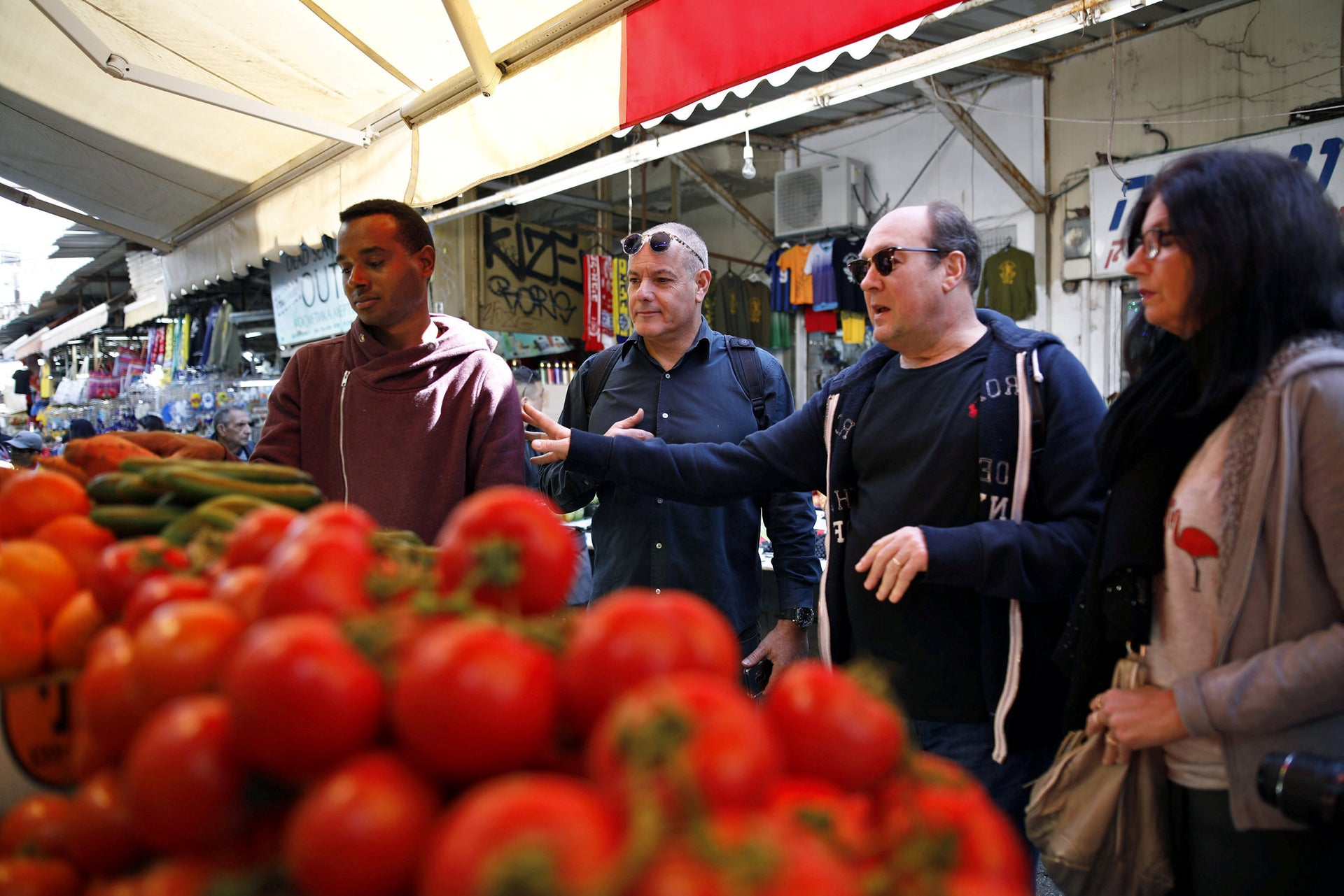At the Carmel market in Tel Aviv, locals and market vendors participate in the special training session.