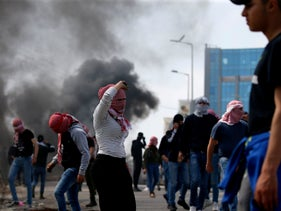 Palestinian demonstrators from Birzeit University clash with Israeli troops in Ramallah, near the Jewish settlement of Beit El, in the occupied West Bank on March 20, 2019.