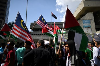File photo: A group of Muslim demonstrators carrying Palestinian flags rally outside the Australian embassy in Kuala Lumpur, Malaysia, December 21, 2018.