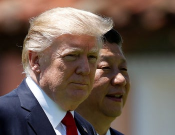 In this April 7, 2017, file photo, U.S. President Donald Trump, left, and Chinese President Xi Jinping walk together at Mar-a-Lago in Palm Beach, Fla.