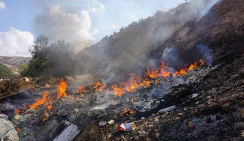 The burning of electronic waste at the West Bank village of Idhna.