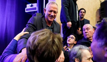 Benny Gantz, one of the leaders of the Kahol Lavan political alliance, greets supporters in Haifa on March 17, 2019.