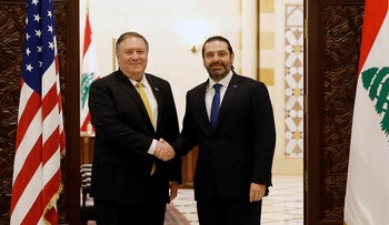 Lebanese Prime Minister Saad Hariri, shakes hands with U.S. Secretary of State Mike Pompeo, left, in Beirut, Lebanon, March 22, 2019.