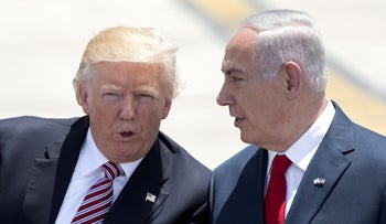 Benjamin Netanyahu, right, and Donald Trump after the U.S. president's arrival at Ben-Gurion Airport, May 22, 2017.