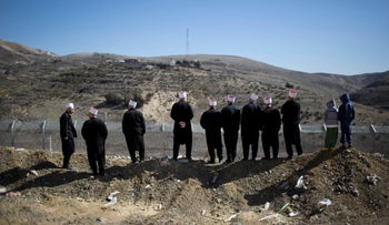 FILE PHOTO:  Druze protesters participate in a rally in Majdal Shams in the Golan Heights, demanding the return of the territory captured by Israel in 1967, near the Syrian border, February 14, 2014.