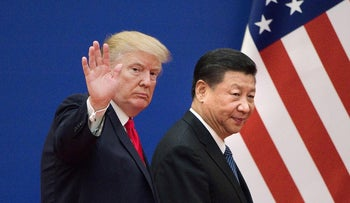 U.S. President Donald Trump and Chinese President Xi Jinping leave a business leaders event at the Great Hall of the People in Beijing, November 9, 2017.