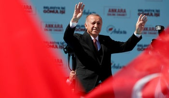 Turkish President Tayyip Erdogan greets AK Party and Nationalist Movement Party (MHP) supporters during a rally for the upcoming local elections in Ankara, Turkey, March 23, 2019.