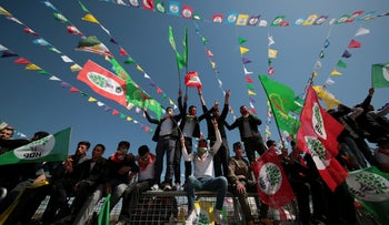 People wave pro-Kurdish Peoples' Democratic Party (HDP) flags during a gathering to celebrate Newroz, which marks the arrival of spring and the new year, in Diyarbakir, Turkey, March 21, 2019.