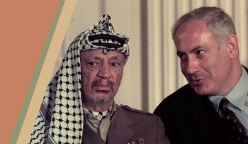 During a press briefing in the East Room of the White House, Wednesday, Yasser Arafat sat stone faced as Israeli Prime Minister Benjamin Netanyahu whispered something in his ear