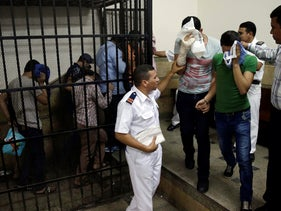 File photo: Egyptian men convicted for 'inciting debauchery' following their appearance in a video of an alleged same-sex wedding party leave the defendant's cage in a courtroom in Cairo, November 2014.