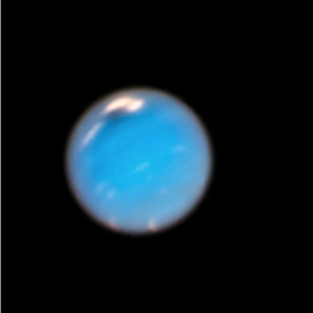 composite picture shows images of storms on Neptune from the Hubble Space Telescope (left) and the Voyager 2 spacecraft (right)