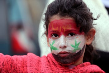 A Druze girl at a rally over U.S. President Donald Trump's support for Israeli sovereignty over the Golan Heights, in Majdal Shams in the Israeli occupied Golan Heights. March 23, 2019