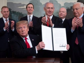 US President Donald Trump holds up a signed Proclamation on the Golan Heights alongside Israeli Prime Minister Benjamin Netanyahu in the White House in Washington, DC, March 25, 2019