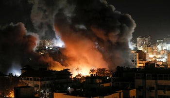 Fire and smoke above buildings in Gaza City during reported Israeli strikes on March 25, 2019.