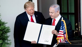 U.S. President Donald Trump and Israel's Prime Minister Benjamin Netanyahu hold up a Golan Heights proclamation outside the West Wing after a meeting in the the White House March 25, 2019.